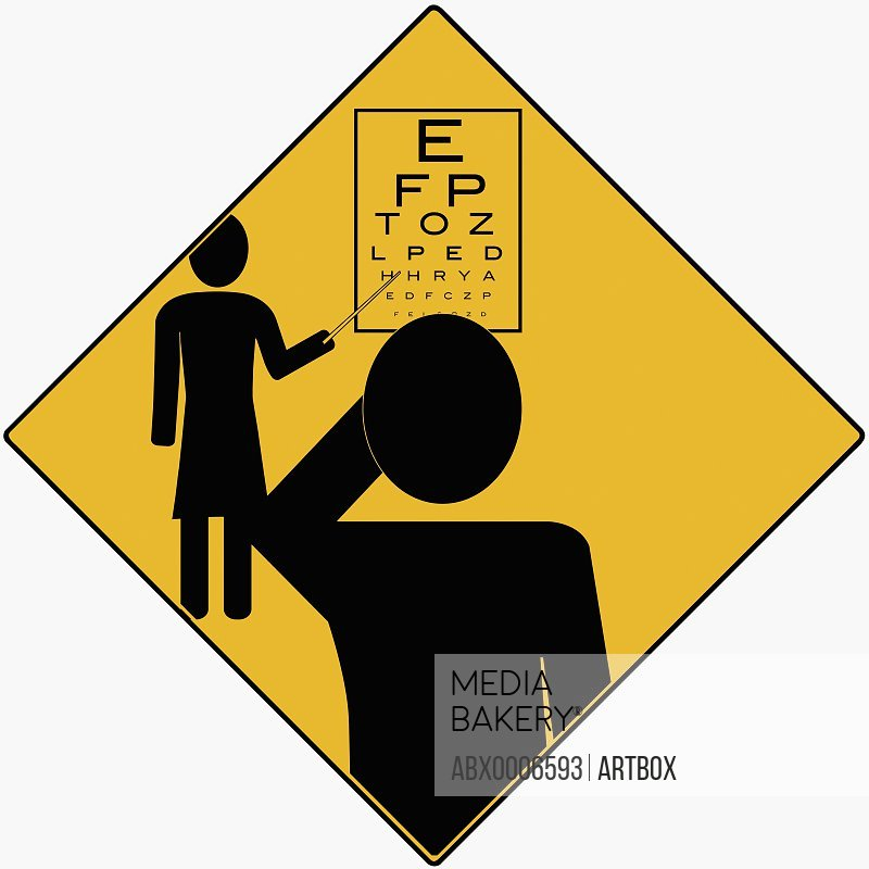 Optometrist pointing at an eye chart