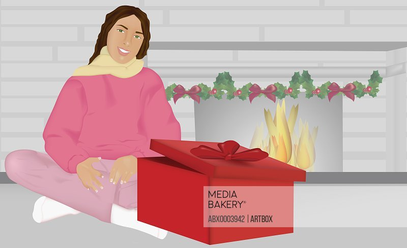 Woman sitting behind an unwrapped Christmas present