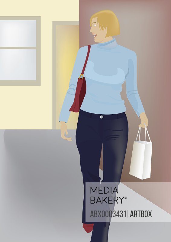 Woman walking on a road carrying a shopping bag