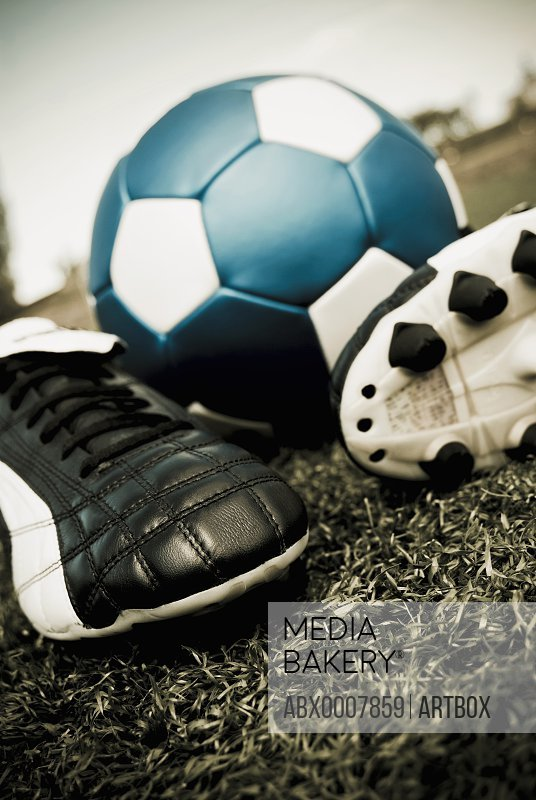 Close-up of a soccer ball and a pair of shoes