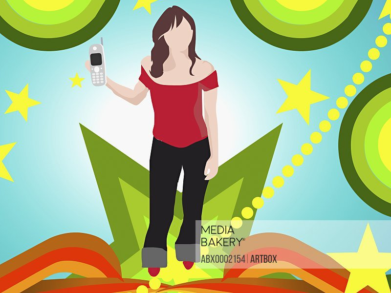 Woman standing and holding a mobile phone