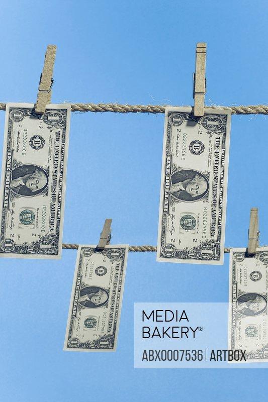 US banknotes hanging on clothesline