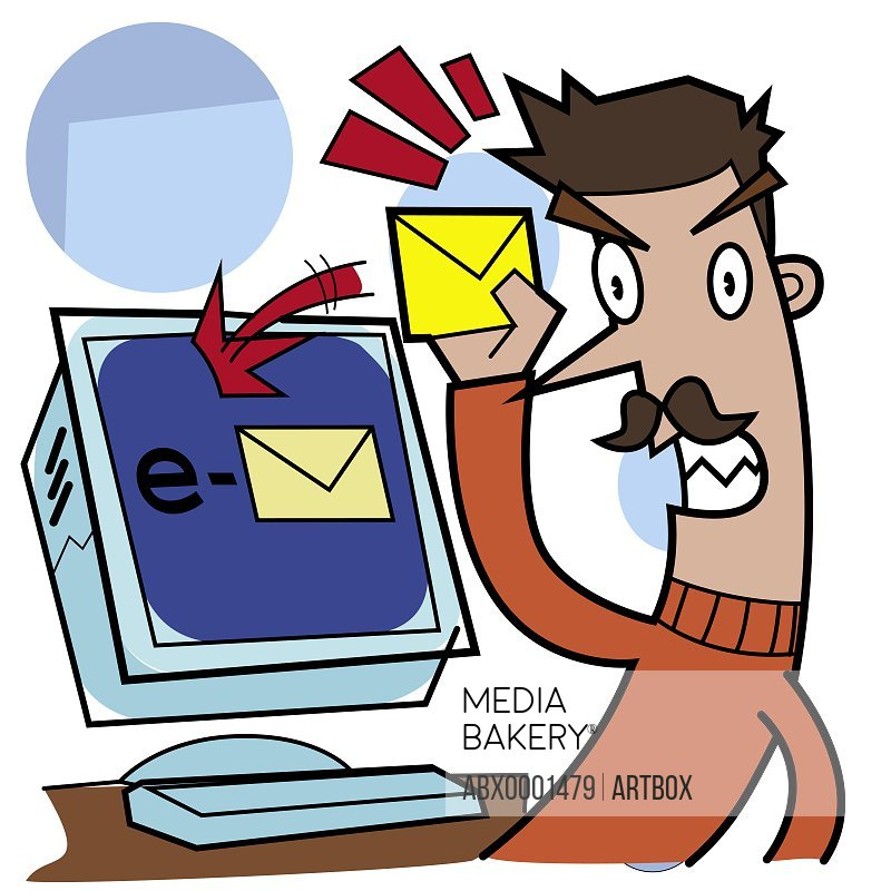 Man holding a letter near a computer