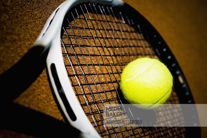 Close-up of a tennis ball on a tennis racket