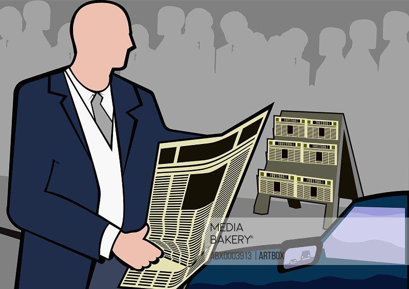 Businessman reading a newspaper near a car