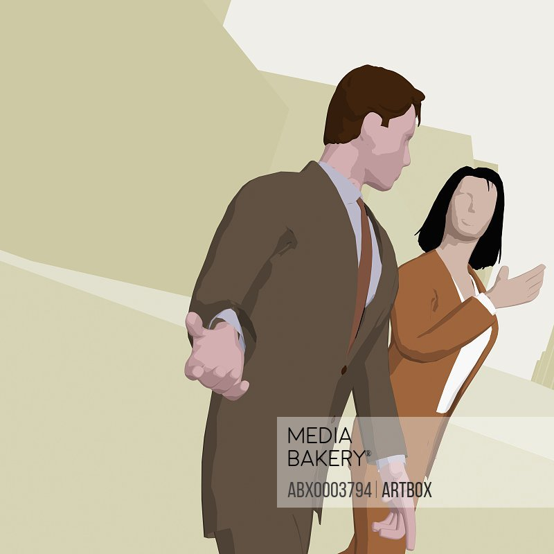 Businessman and a businesswoman walking on the road