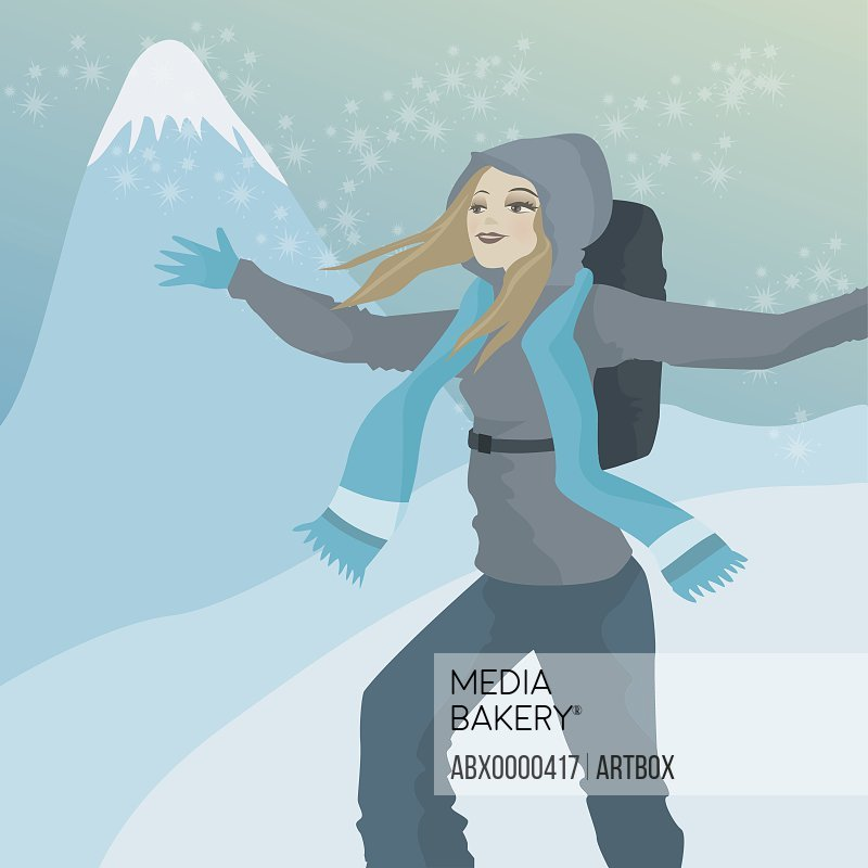 Woman standing in the snow with her arms outstretched