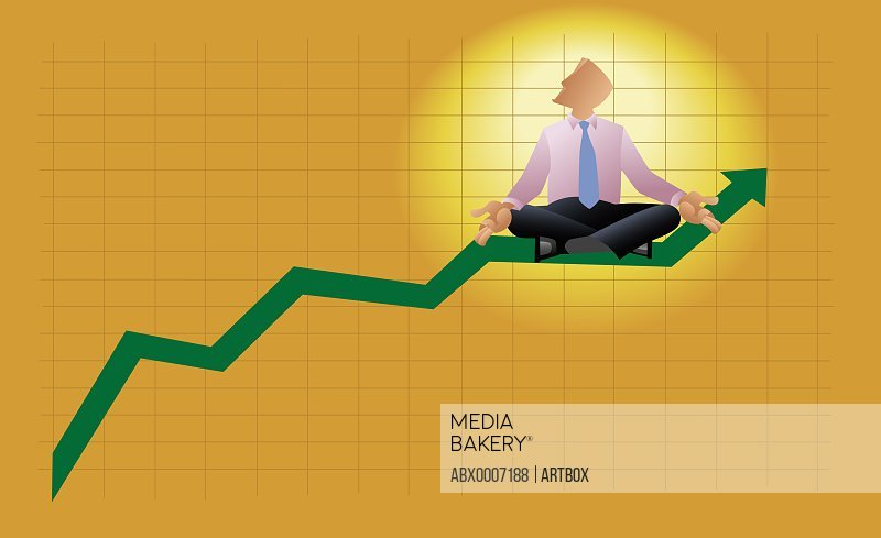 Businessman meditating on a line graph