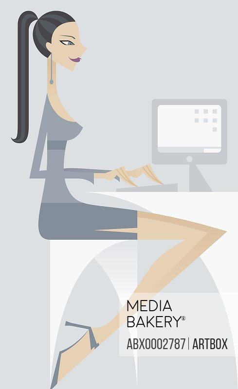 Businesswoman working on a desktop pc