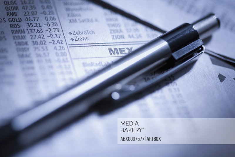 Close-up of a pen on a stock market report