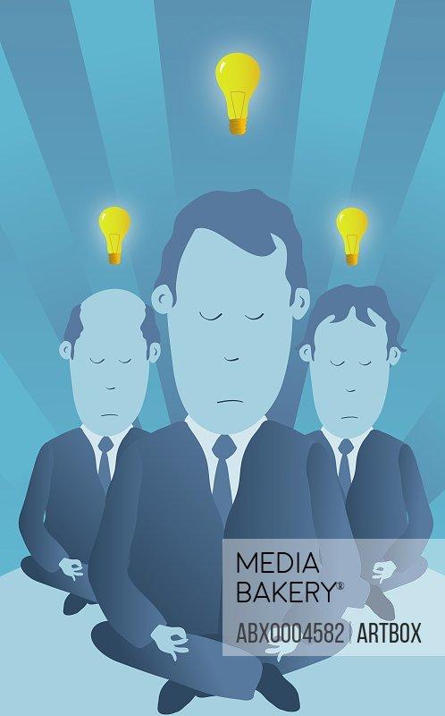 Three light bulbs lit up over three businessmen