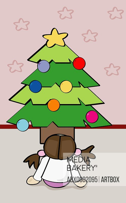 Rear view of a girl sitting in front of a Christmas tree