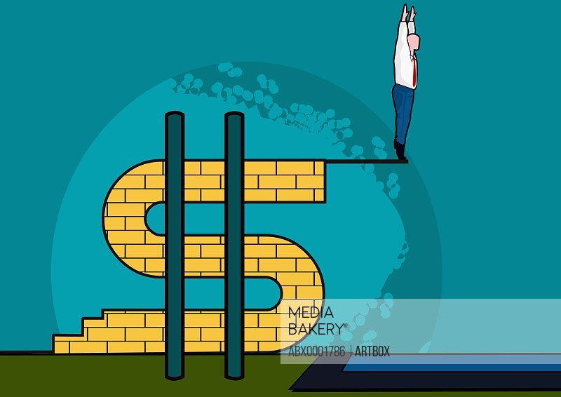 Man standing on a platform at the edge of a dollar sign