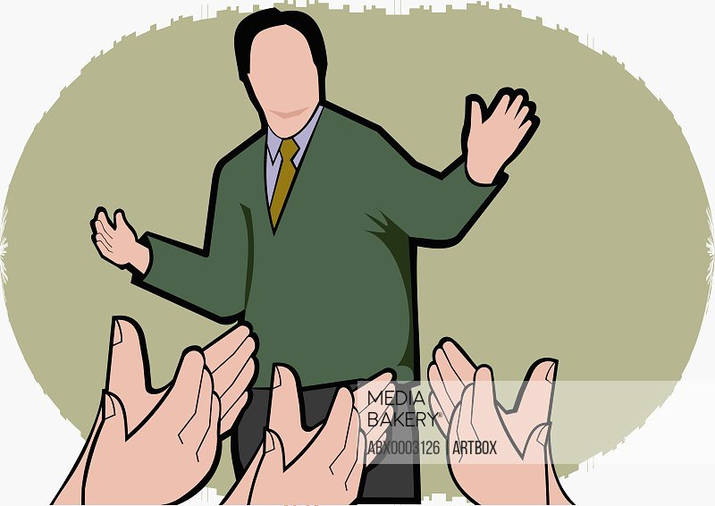 Man with arms outstretched and people clapping