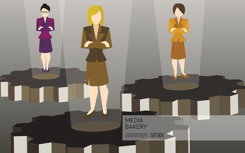 Three businesswomen standing on cog wheels