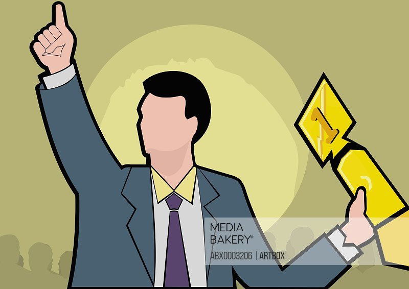 Businessman holding an award and pointing up