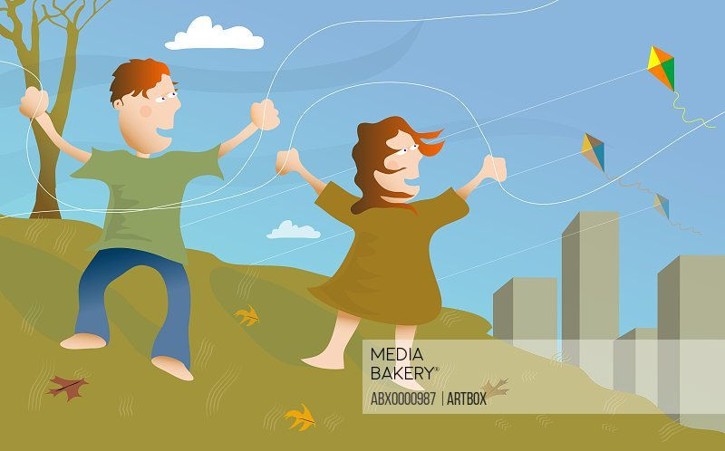 Boy and a girl flying kites