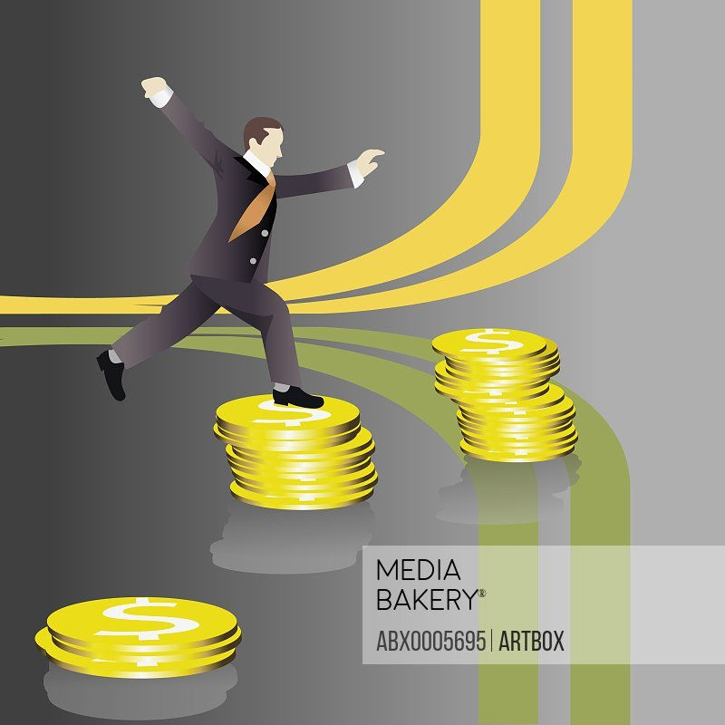 Businessman standing on a stack of dollar coins