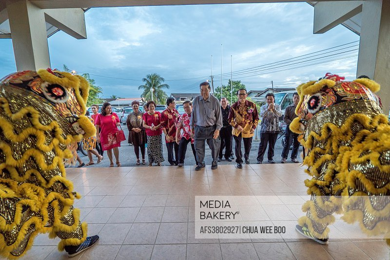 Lion dance welcoming guests during Chinese New Year dinner at Sungai Maong Community Hall, Kuching, Sarawak, Malaysia.