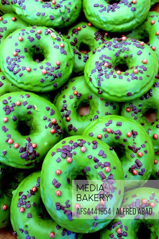 green pastry donuts