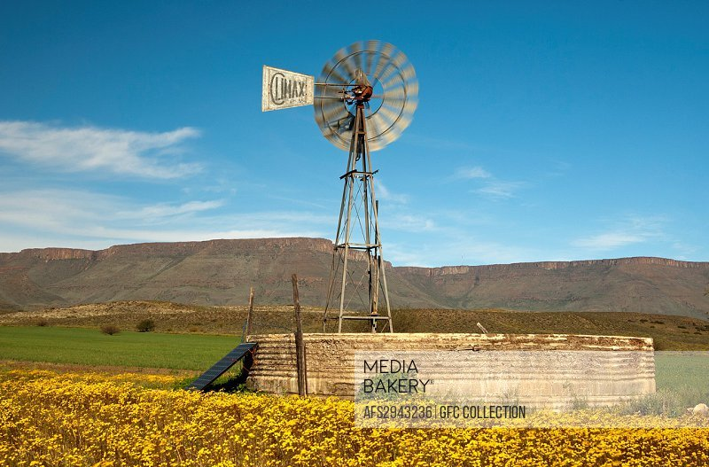 Solarenergy-supported windmill of an irrigation pump in the Hantam Karoo at the feet of the Hantam Mountains, Western Cape province, South Africa