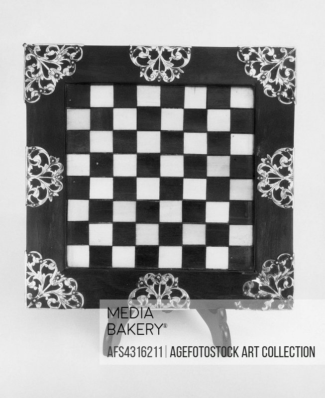 Chessboard. Date: third quarter 17th century; Culture: British; Medium: Ivory, ebony, and silver; Dimensions: 7 x 7 in. (17.8 x 17.8 cm); Classificati...