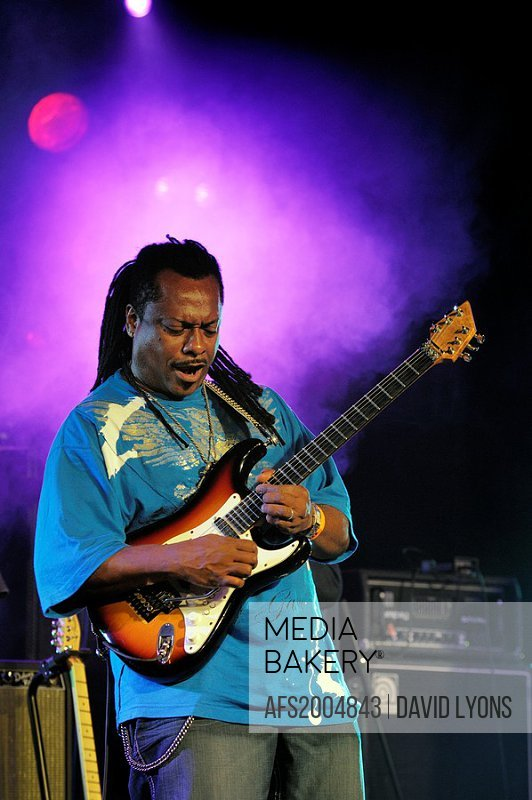 Lead guitarist with the Booker T  Jones band plays solo break  Main stage marquee  Maryport Blues Festival, 2010  England