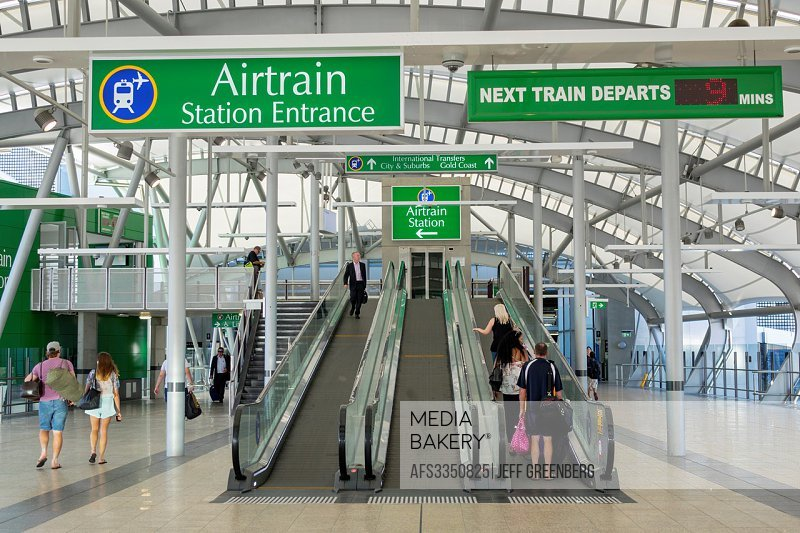 Australia, Queensland, Brisbane, Brisbane Airport, BNE, terminal, concourse, Airtrain, public transportation, station, entrance, escalator, moving sid...