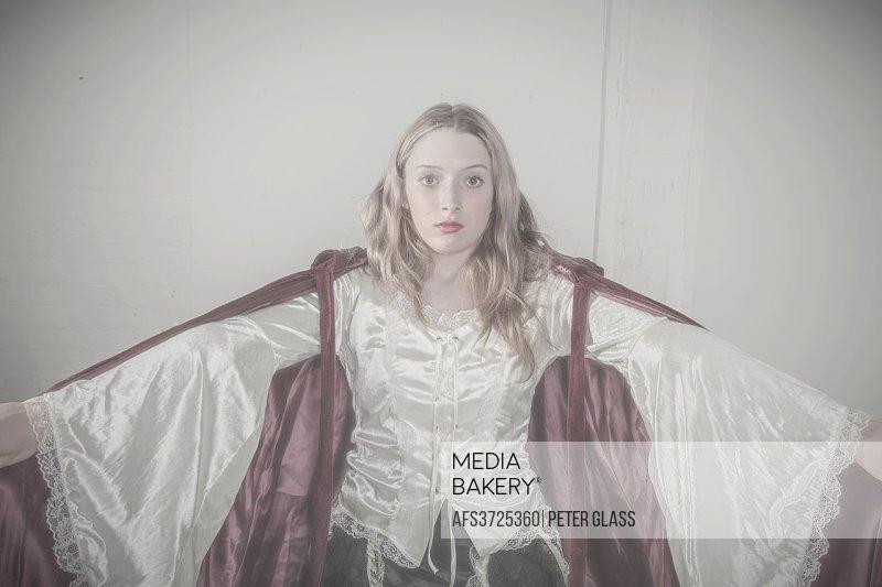 Blonde teenage girl wearing a robe.