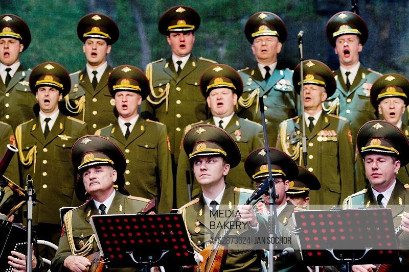 """Singers and the balalaika players of the Russian Army Choir """"Alexandrov Ensemble"""" performing in the concert given in a small Czech town Loket, 14 June..."""