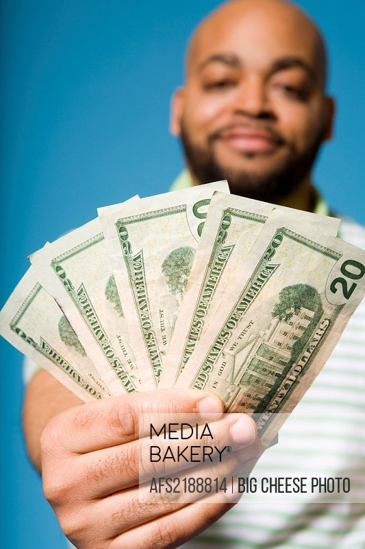 Man holding twenty dollar bills