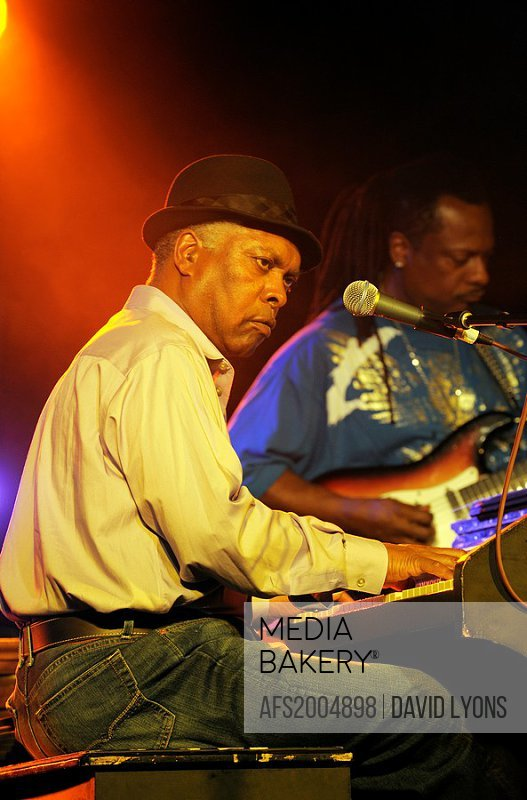 Booker T  Jones, US blues singer musician plays Hammond B3 organ  Main stage marquee  Maryport Blues Festival, 2010  England