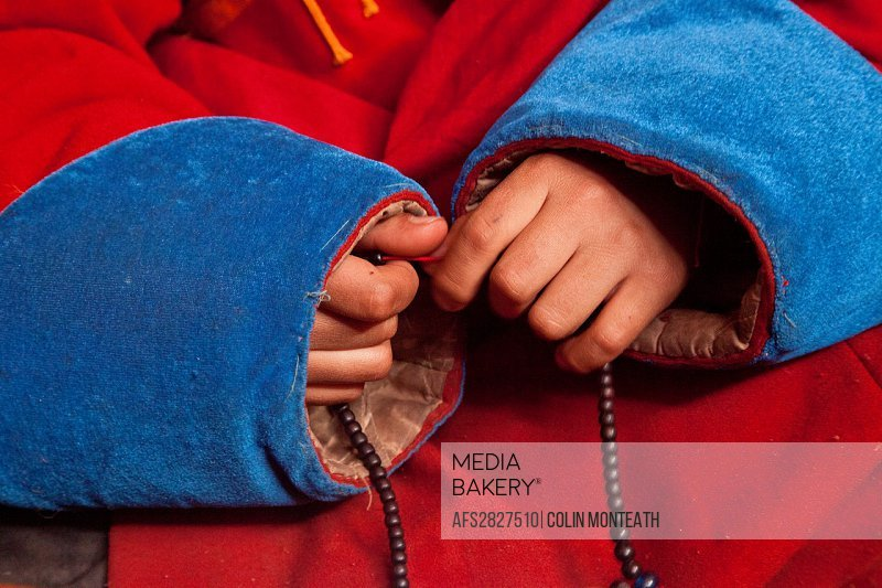 Young monk recites prayers, fingers prayer beads, Amarbayasgalant Buddhist monastery, built 1727, Selenge province , northern Mongolia