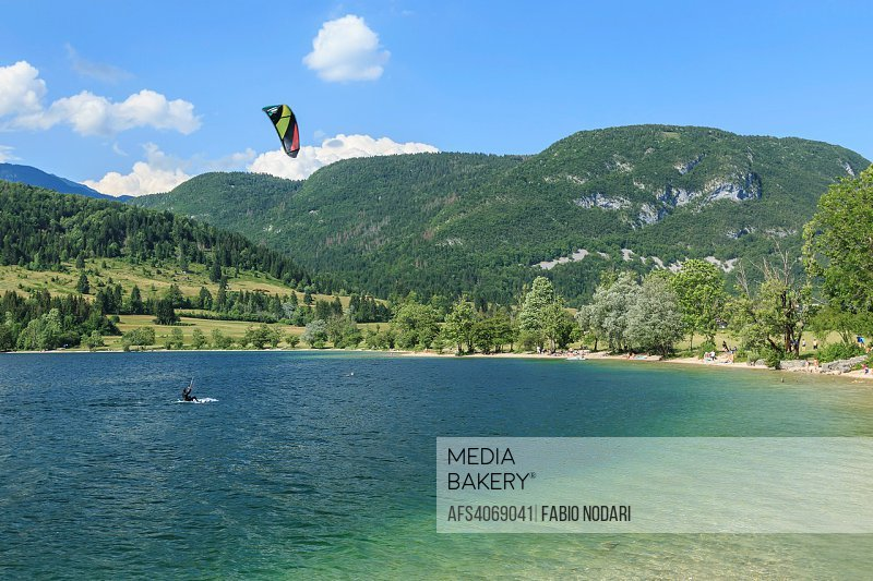 Tourist paragliding on lake Bohinj a famous destination not far from lake Bled, in Slovenia.