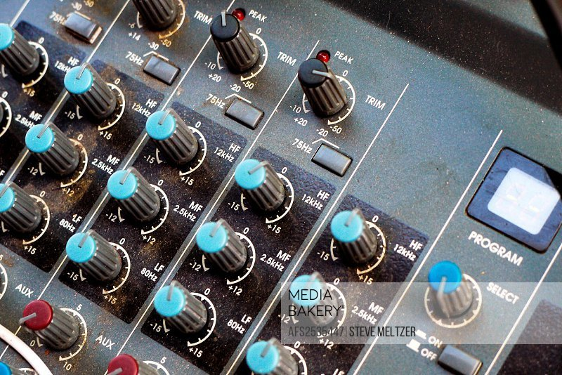 The control knobs on an audio mixing board