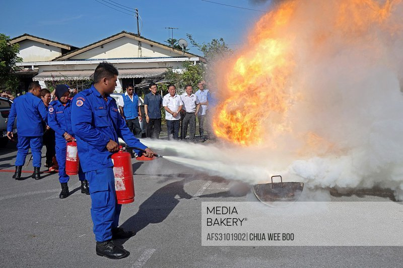 Fire extinguisher demonstration by Civil Defence´s personnel at Sg. Maong Community Hall, Kuching, Sarawak, Malaysia..