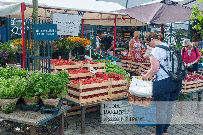 Shopping at the Torvehallerne produce market, Copenhagen.
