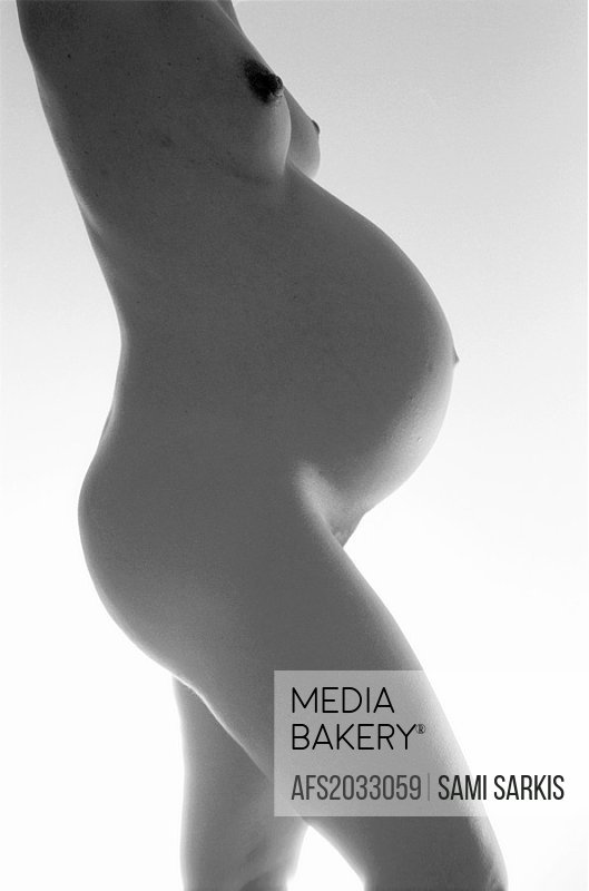 Nude silhouette of a pregnant woman.