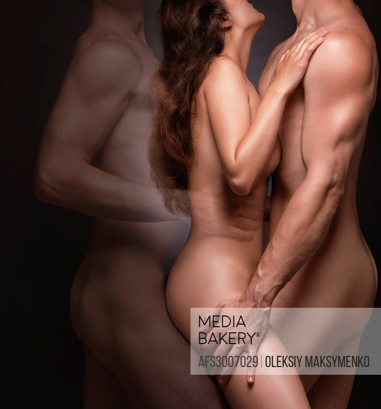 Erotic fantasy photo of a naked couple  Nude woman and a man with a ghost of a second man behind her