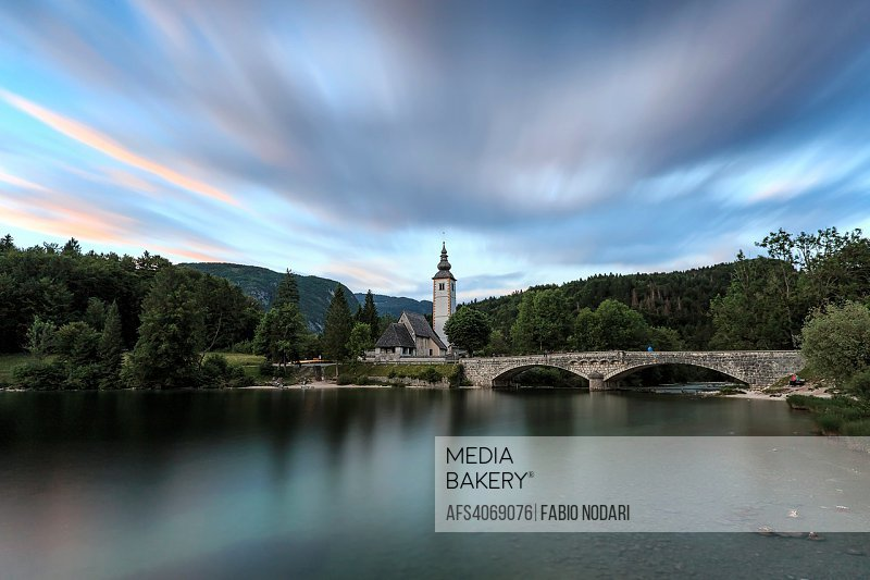 Church of St John the Baptist in Lake Bohinj, a famous destination not far from lake Bled in Slovenia, at sunset.
