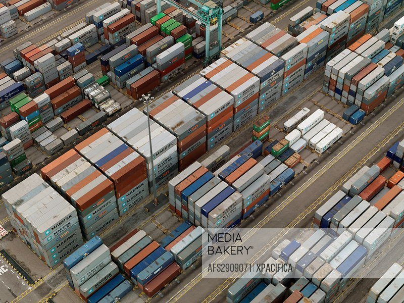 Cargo Containers and freighters at Port of Singapore Authority