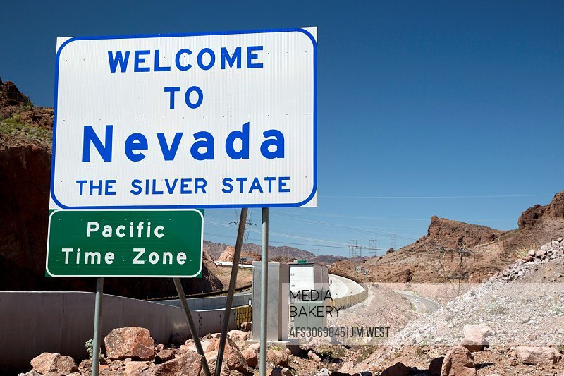 Boulder City, Nevada - A sign welcomes drivers on US 93 to Nevada as they cross a bridge from Arizona over the Colorado River.