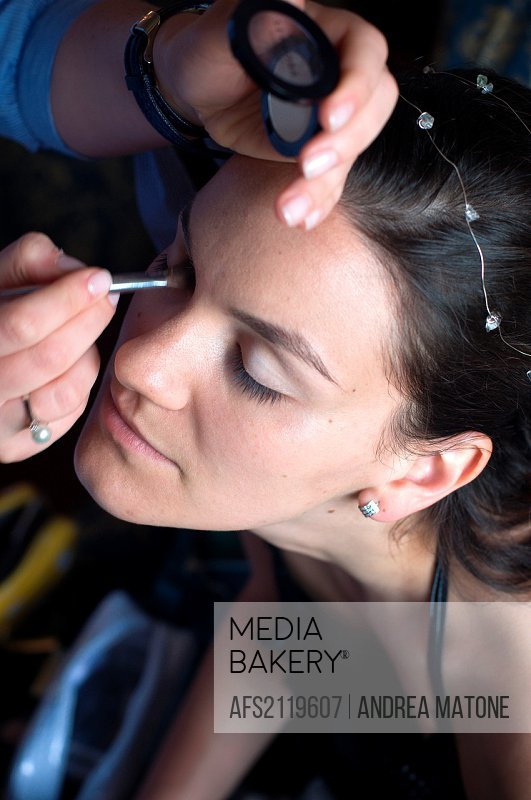 Woman receiving make-up application