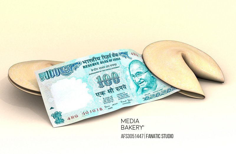 One hundred rupee note with fortune cookies