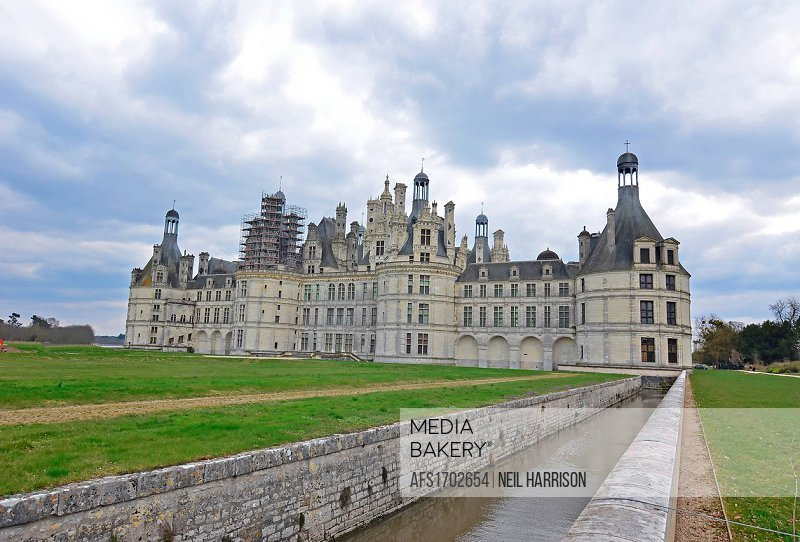 The royal Chateau de Chambord with a canal leading to the ornamental moat.