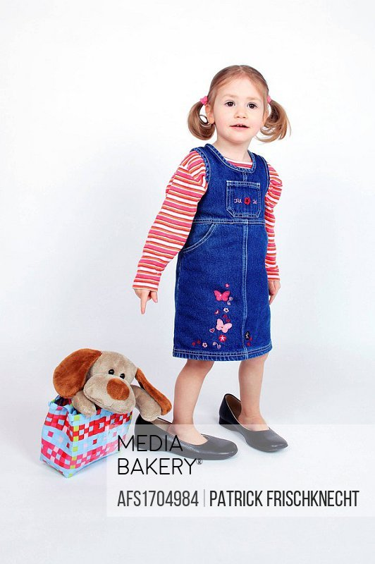 Toddler Little Wearing Dress And Grown Up Shoes Standing Next To