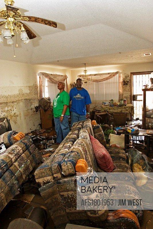 New Orleans, Louisiana - September 18, 2005 - Michele Baker and her husband Alexander inspect the Hurricane Katrina devastation of their home in east ...