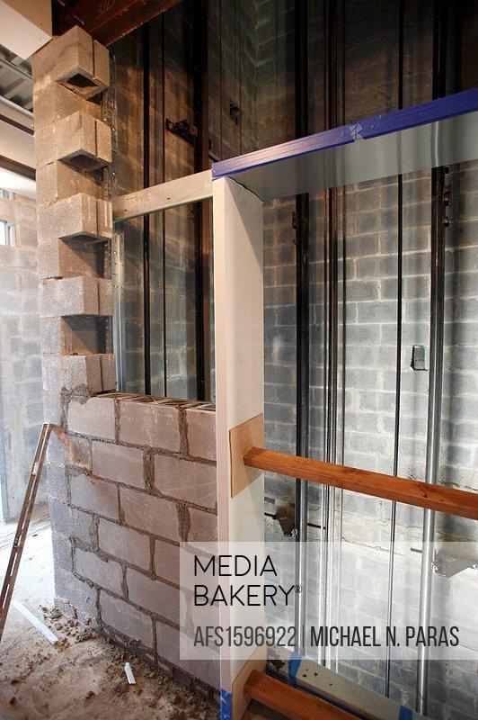 Elevator shaft under construction with cement block