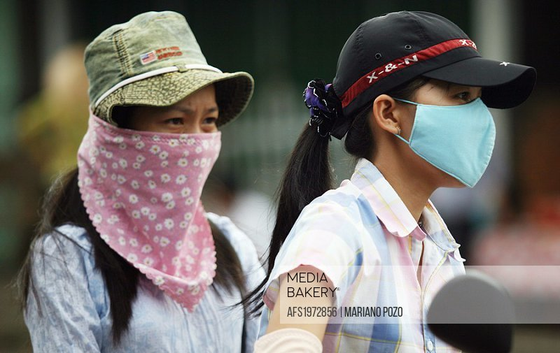 Women protected of air polution,  Hanoi, Vietnam