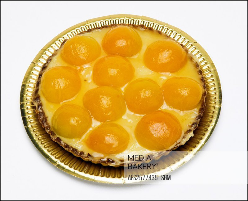 Whole apricot pie on platter